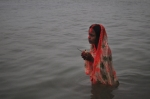nov 1, 2011, 5.00 am. Ferry Ghat, a woman praying during the Puja
